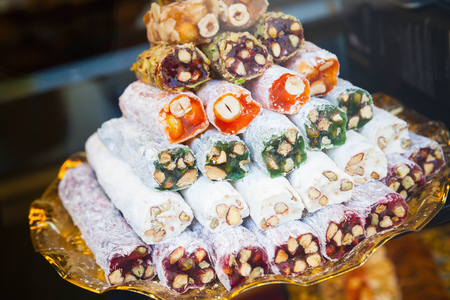 cuisines: Assortment of Turkish delight on the counter. Traditional cuisines of the former Ottoman Empire and the Middle East. Photo with selective focus Stock Photo