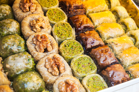 filo: Assorted baklava, it is sweet pastry made of layers of filo with chopped nuts and sweetened and held together with honey. Traditional for former Ottoman Empire and Middle East, selective focus