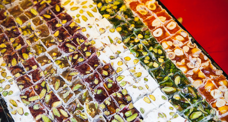 locum: Assortment of Turkish delight. Traditional cuisines of the former Ottoman Empire and the Middle East. Photo with selective focus Stock Photo