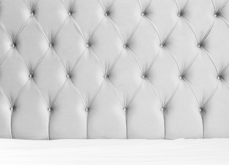 headboard: Luxury empty bedroom interior background, soft gray headboard and white bedding sheets on wide double bed Stock Photo