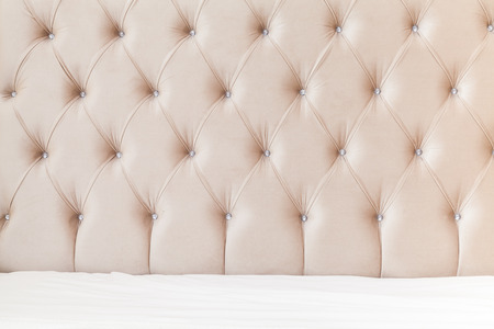 headboard: Luxury empty bedroom interior background, soft pink headboard and white bedding sheets on wide double bed Stock Photo