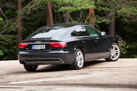 typ: Kotka, Finland - July 16, 2016: Black Facelift Audi A5 2.0 TDI 2012 model year Facelift car, closeup rear view