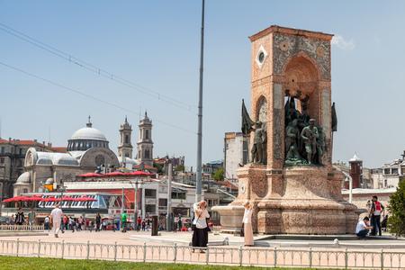 ordinary: Istanbul, Turkey - July 1, 2016: Ordinary people walking on Taksim square near the Republic Monument