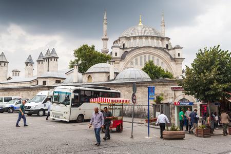 turkish people: Istanbul, Turkey - June 28, 2016: Ordinary Turkish people walk on the street near Nuruosmaniye Mosque in Istanbul Editorial