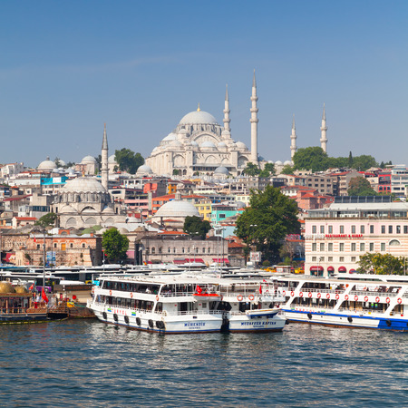passenger ships: Istanbul, Turkey - July 1, 2016: Cityscape with passenger ships in Golden Horn a major urban waterway and the primary inlet of the Bosphorus, photo taken from Galata bridge Editorial
