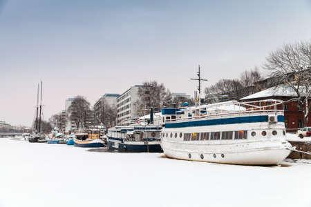 turku: Winter cityscape of Turku, Finland. Ship restaurant moored in ice near main embankment Stock Photo
