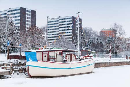 turku: Winter cityscape of Turku, Finland. Ship restaurant moored in ice