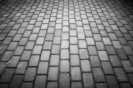 cobble: Gray cobble road background photo with perspective effect