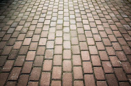 cobblestone road: Red cobblestone road background photo with perspective effect