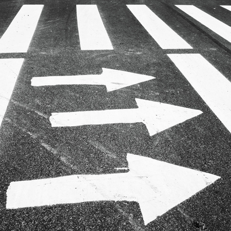 highway 3: Zebra, pedestrian crossing with road marking. White arrows and rectangles on the dark asphalt