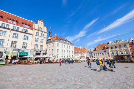 town hall square: Tallinn, Estonia - May 2, 2016: Raekoja plats. Panorama of the central Town Hall Square with walking tourists Editorial