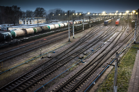 sorting: Sorting railway station with cargo trains on rails at night