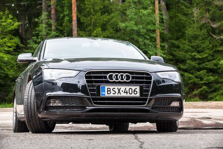 typ: Kotka, Finland - July 16, 2016: Black Facelift Audi A5 2.0 TDI 2012 model year Facelift car, closeup front view Editorial