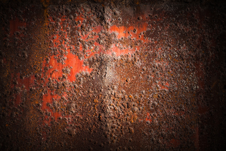 corrosion: Old dark red rusted iron wall, industrial background photo texture with vignette effect