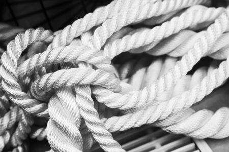 White nautical rope bundle, close up monochrome photo Stock Photo