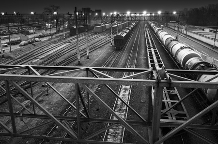 ferm: Sorting railway station with illumination at night, black and white photo