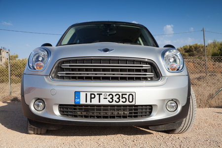 crossover: Zakynthos, Greece - August 18, 2016: Silver gray Mini Countryman subcompact crossover, closeup front view