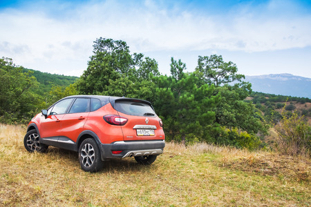 fourwheeldrive: Novorossiysk, Russia - August 21, 2016: New Renault Kaptur car. It is a Russian version of subcompact crossover Renault Captur with extended wheelbase, elevated ground clearance and four-wheel-drive