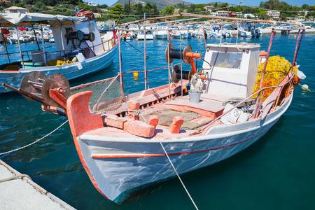 Vintage wooden fishing boat moored in port of Agios Sostis village. Zakynthos, Greek island in the Ionian Sea Stock Photo