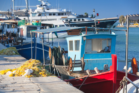 trawler net: Colorful wooden fishing boats moored in port of Zakynthos, Greece