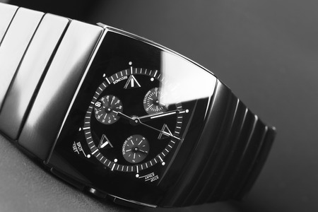 the chronograph: Mens chronograph watch made of high-tech ceramics with sapphire glass over black. Selective focus