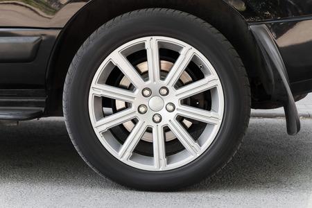 alloy: Modern automotive wheel on light alloy disc Stock Photo