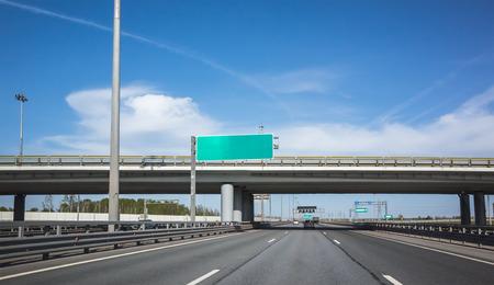 information highway: Wide highway equipment, green information banner over the road
