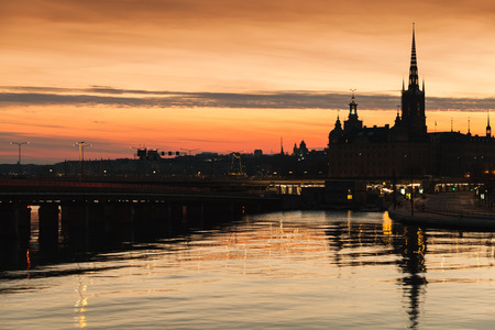 Silhouette cityscape of Gamla Stan city district in central Stockholm with German Church spire as a skyline dominant Stock Photo