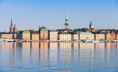 Cityscape of Stockholm. Gamla Stan city district in summer morning with German Church spire as a skyline dominant