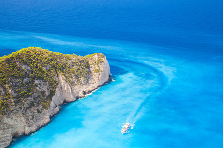 ship wreck: Touristic motor boat goes on Navagio Bay to the Ship Wreck beach. The most famous nature landmark of Greek island Zakynthos in the Ionian Sea