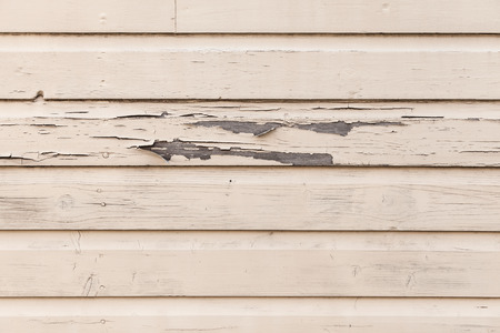 biege: Old biege wooden wall with peeling paint layer, detailed background photo texture Stock Photo