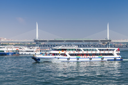 Istanbul, Turkey - July 1, 2016: White passenger ferry goes on Golden Horn. It is a major urban waterway and the primary inlet of Bosphorus in Istanbul