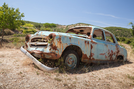 Zakynthos, Greece - August 20, 2016: Old abandoned rusted retro car stands in summer garden Sajtókép