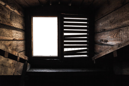 upper floor: Empty attic window with shutters in old grunge wooden interior Stock Photo