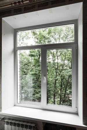 dark interior: New window just after installation in dark interior under renovation