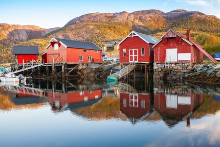 Traditional Norwegian red wooden barns stand on the sea coast. Snillfjord, Sor-Trondelag region, Vingvagen fishing village