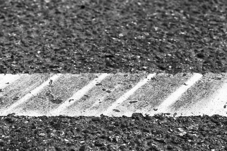White line with tire tracks over it, highway road marking fragment. Abstract transportation background Stock Photo