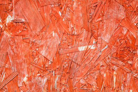 oriented: Bright red painted oriented strand board OSB. Sterling board background photo texture