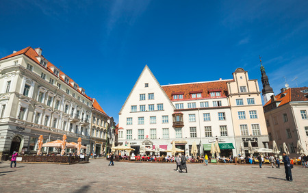 Tallinn, Estonia - May 2, 2016: Tourists and citizens are on Town Hall square in old Tallinn, bright spring sunny day
