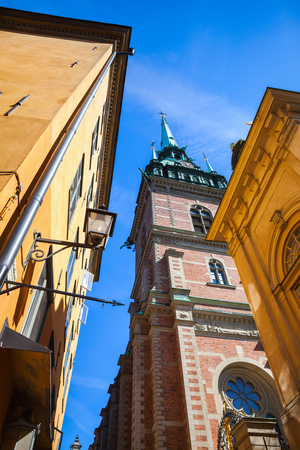 gothic revival: Street view of old Stockholm town with The German Church, also called called St. Gertrudes Church in Gamla stan, Sweden