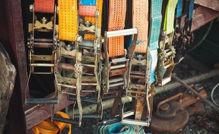 buckles: Colorful slings with steel buckles, vintage toned photo, old style effect