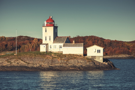 Tyrhaug Lighthouse. Coastal tower located in Smola Municipality, More og Romsdal county, Norway. The lighthouse was established in 1833. Vintage tonal correction filter Stock Photo