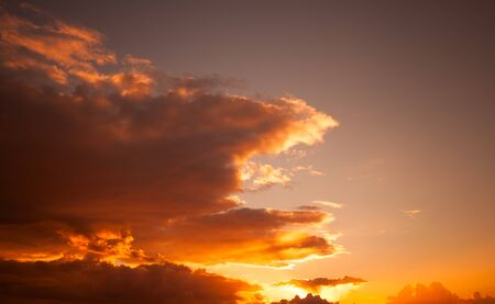 Natural photo background with colorful evening sky with warm tonal correction filter