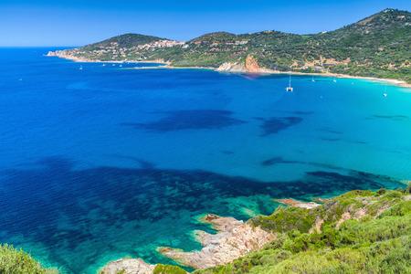 Coastal landscape of South Corsica. Small azure bay with yachts, Piana region, France Stock Photo