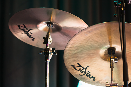 St. Petersburg, Russia - May 2, 2016: Cymbals by Avedis Zildjian Company, commonly known as Zildjian, closeup photo with selective focus Editorial