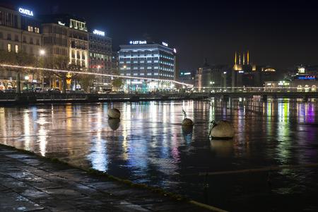 Geneva, Switzerland - November 24, 2016: Night cityscape with illuminated building facades of Geneva city