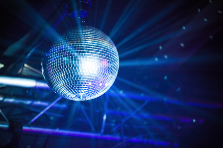 Disco ball with blue rays, night party background photo