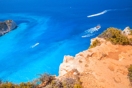 ship wreck: Touristic pleasure boats in Navagio Bay, Ship Wreck beach. The most famous nature landmark of Greek island Zakynthos in the Ionian Sea Stock Photo