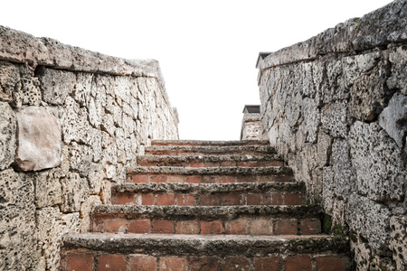 coquina: Ancient stone stairway goes up isolated on white background