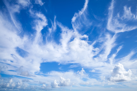 Blue sky with white altocumulus and cirrus clouds layers, natural background photo texture